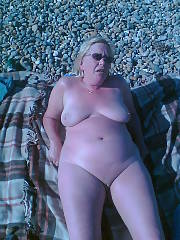 My sexy wifey naked on the beach...wife just loves to sunbathe naked...and loves mates getting off on her