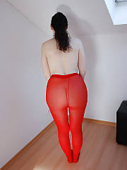 Mature lady in red tights positions on cam.