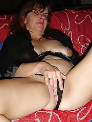 Sexy mature woman toying her pussy.