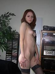 Mature red-haired shows off her shaved pussy. i wonder if she has red pubes or not?
