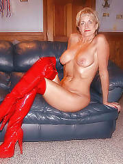 Blondie mom in red boots teasing on couch.