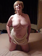 Sexy busty mom playing her pinkish vagina on bed.