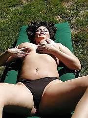 Beautiful boobed black haired mom having fun outdoor.
