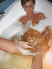 Nice amateur MILF having joy in the tub.