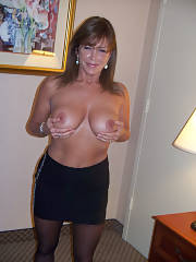 Homemade mother cupping her full hooters