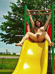 Happy mature lady riding a yellow hill with wide spreaded legs and shows her hot feet