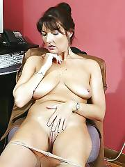 Mature lady in stockings jerking her twat at the office.