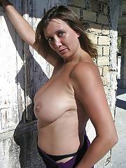 Busty mamma poses nude outdoor.