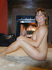 Naughty mature biz lady getting nude and wanking her sloppy snatch.