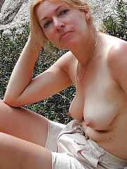 Hot red-haired MILF alma getting naked.