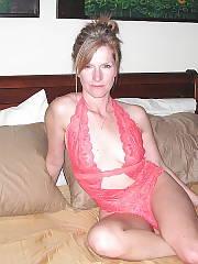 MILF wifey in underwear poses in bed.