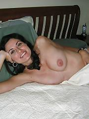 Sexy amateur brunette mother likes exposing her bautiful boobies on cam.