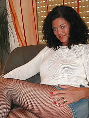 Brunette mature mamma having fun at home