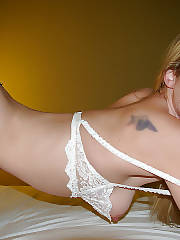 Hot blonde mother katie positions naked on bed.