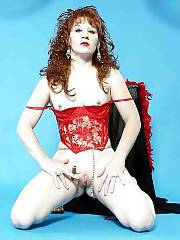 Hot red-haired mom with cigar poses nude on cam.