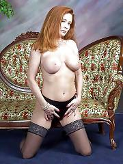 Mamma with nice backside positions naked while wearing a black stockings.
