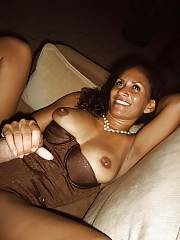 Sexy ebony mother wanking and blowing cock.