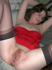 Sexy mamma in red exposing her sweet vagina on cam.