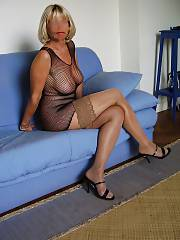 My mature wifey in a slutty fishnet dress.
