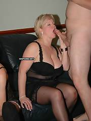 Big pretty mature lady from England is having gang drill with many dudes at swinger orgy, watch her blowing many penises and taking facial cum shots - amateur xxx photos