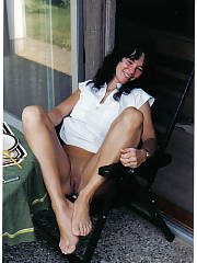 Jutta - hot amateur german housewife..this sleazy black haired wifey is exposing what her country has to offer.  beaten up pussy and beer!!!!