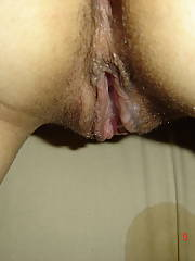 My old ladies backside and pussy.  this is what a used and abused ex strippers cunt looks like