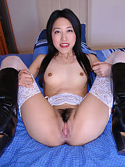 Eriko may look like a pretty and innocent japanese cutie, but she actually a MILF and part time whore! on this occasion she enjoys to strip, spread and pose while playing with a huge red fucktoy on her tight, trimmed pussy, before she grabs a huge white p