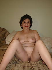 Taking time to position - she likes to position nude and show off her lovely grandma body and sweet unshaved vagina