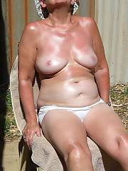 Me old woman showing off her showing off her bits and bites for the lens.  she fell asleep outside and woke up wet and naughty