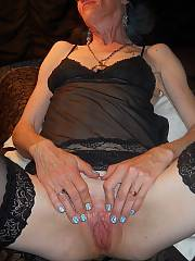Mature woman models first time indoors