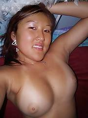 Young asian superhottie tina - tina takes some pictures of her self around the house and liked to pose by windows