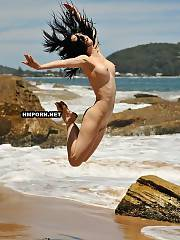 Nudist and naturist babes jumping naked on the beach and spreading legs in the air flashing their sweet pussies