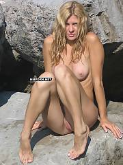 Horny blondie nymph walking and posing naked at the rocky beach, flashes pussy, fuckable ass, hot legs and feet from various angles