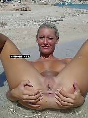 Voyeur shots at the nudist and naturist beach.., nice girls and middle-aged hot women sunbathing naked and flashing vaginas