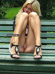 Charming blondie chick flashes puffy vagina lips updkirt on the bench in public city park
