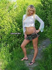 Horny blond girlie playing outside, She is undressing and spreading legs wide in various positions.., While horny strangers are walking around and seeing it