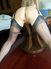 Homemade sex - Chic middle-aged mistress wears her sexiest stockings and high heels to tease boyfriend and make him as hard as possible, watch her beautiful bald pussy between long hot legs