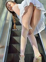 Risky gals flashing naked pussies under skirt in public