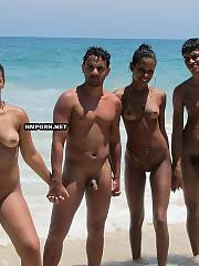Nudist and naturist gals and nice couples walking and sunbathing nude on the beaches worldwide and get caught by voyeurist taking sexy voyeur photos of sexy nude bodies