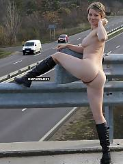 Tall short haired lady takes her dress off on the bridge at public place, see her posing nude and showing twat close up, so you can see the cars running on the background as well