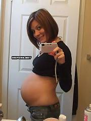 Girlfriend got pregnant and now enjoys to make nude selfie pics in front of the mirror, She looks so hot with huge pregnant belly and small boobies becoming so fuckin milky - amateur porn photos