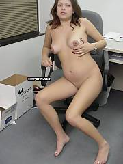 Lovely babe took her dress off in the office and started teasing her coworker by showing her nude body for him, He got naughty and dropped camera to penetrate this beauty right on chair at the computer table, but that was not filmed - amateur porn pics