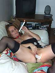 Nasty slut with candles up her cunt, thats some weird kinky shit!