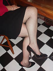 Creepy mamma flashing her twat through her fishnets, not sure if itd hit it or not