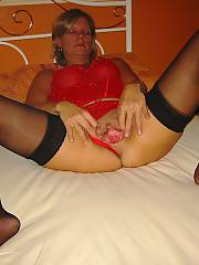 My old woman playing with her pussy, she gets off on bizarre insertions