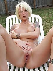 Tattooed light haired outdoor masturbation