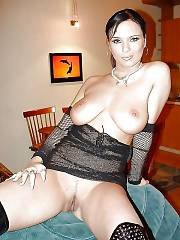 Boobed mature julia showing her massive melons and spreading her pussy.