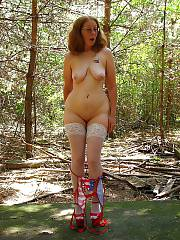 Outdoor mature in stockings posing nude.