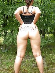 Naughty curvy ex-girlfriend stroking her wet pussy in the woods.