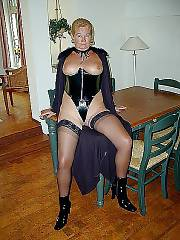Smoking sexy light haired mom angela in black suit
